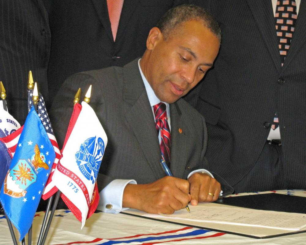 """Gov. Deval Patrick signed the bill as a """"small gesture of our profound thanks."""" (Meghna Chakrabarti/WBUR)"""