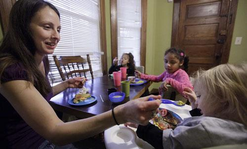 Food stamp recipient Lisa Zilligen, 28, serves lunch to her three children — Miles, 20 months, Olivia, 6, and Danielle, 8 — in her home in Chicago, Nov. 23, 2009. (AP)