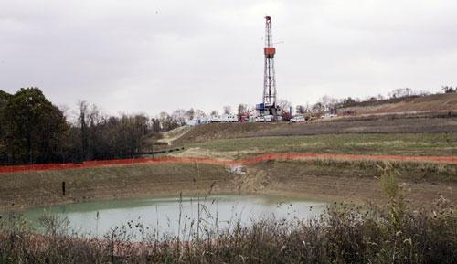 A drilling rig used to bore thousands of feet into the earth to extract natural gas from the Marcellus shale deep underground is seen on a farm in Houston, Penn., in October 2008.