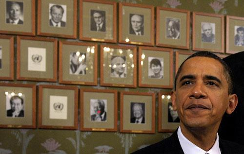 President Barack Obama sits in front of framed photos of previous Nobel Peace Prize winners at the Norwegian Nobel Institute in Oslo, Norway, on Thursday, Dec. 10, 2009. (AP)