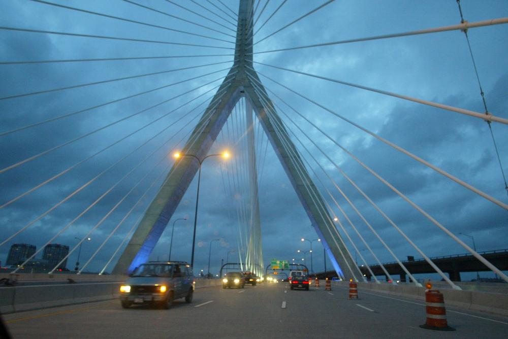 The Massachusetts Department of Transportation will affix red lenses on the lamps illuminating the Zakim Bridge in Boston to mark the 2009 World AIDS Day. (AP)