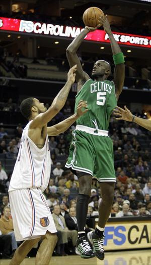 Kevin Garnett shoots over Charlotte Bobcats' Tyson Chandler in the second half of the Celtics' 108-90 win on Tuesday. (Chuck Burton/AP)