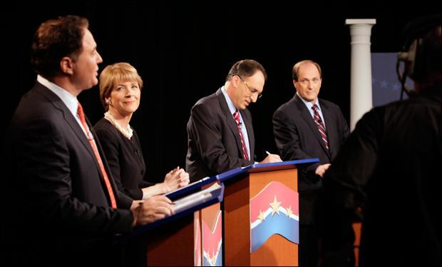 Boston Celtics co-owner Stephen Pagliuca, Attorney General Martha Coakley, City Year co-founder Alan Khazei and U.S. Rep. Michael Capuano chat and check their notes before the start of a televised debate at the WCVB-TV Channel 5 station on Tuesday. (Steven Senne/AP)