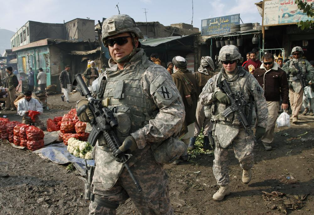 U.S. soldiers patrol through the heart of Kabul, Afghanistan on Wednesday, Dec. 2, 2009.  (AP)