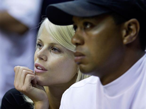 "Tiger Woods has a beautiful wife, cute kids and a big house. So why is he being labeled ""troubled""?  (AP)"