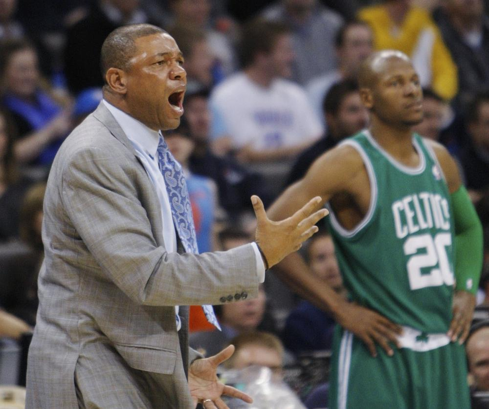 Celtics head coach Doc Rivers, left, shouts at an official during the fourth quarter in Oklahoma City, Friday. Celtics guard Ray Allen, right, looks on.  (AP Photo/Sue Ogrocki)