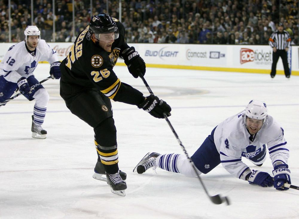 Maple Leafs' Jeff Finger, right, tries to block a shot by  Bruins' Blake Wheeler in the second period,  Saturday, in Boston. (AP Photo/Michael Dwyer)