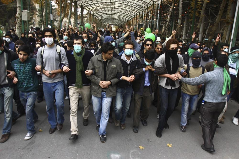 This photo, taken by an individual not employed by the Associated Press and obtained by the AP outside Iran shows pro-reform Iranian students, marching during their protest at the Tehran University campus in Tehran, Iran, on Monday. (via AP)