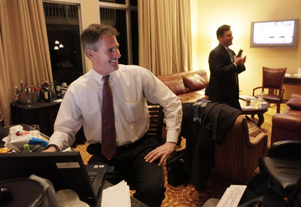 State Sen. Scott Brown reacts as he hears from a campaign staff member in a Newton hotel room that the Associated Press called the primary in his favor. (AP)