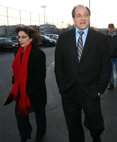 Rep. Michael Capuano and his wife Barbara arrive at the polling station to cast their vote in Somerville on Tuesday. (AP)