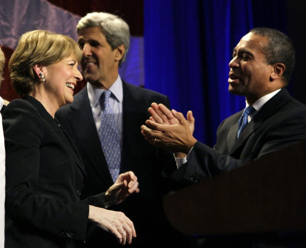 Martha Coakley is applauded by Gov. Deval Patrick and Sen. John Kerry after her win was announced. (AP)