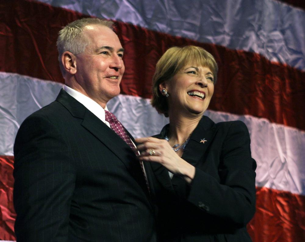 Coakley celebrates with her husband, Thomas F. O'Connor, Jr. (AP)