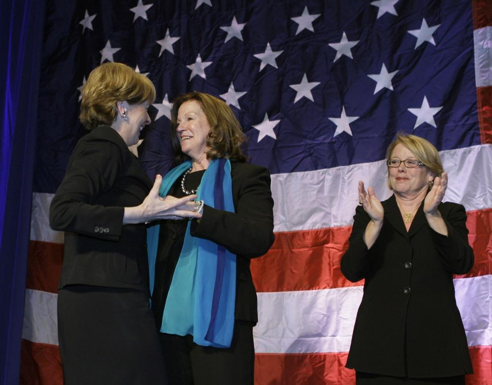 Coakley is greeted on stage by Massachusetts Senate President Therese Murray and Rep. Niki Tsongas, right. (AP)