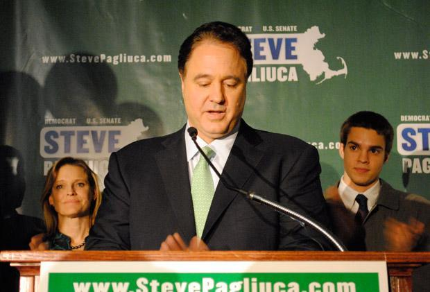Stephen Pagliuca gives his concession speech as his wife and son look on. (Molly Connors for WBUR)
