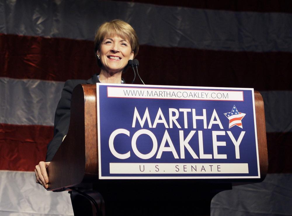 Attorney General Martha Coakley checks the podium at the Sheraton Hotel in Boston on Tuesday. (AP)