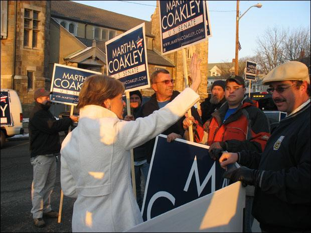 Attorney General Martha Coakley greets voters outside her polling station in Medford. (Monica Brady-Myerov/WBUR)