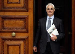Britain's Chancellor of the Exchequer Alistair Darling leaves the Treasury to deliver his pre-budget report. (AP)