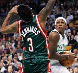 Rajon Rondo drives for the basket against Milwaukee Bucks' Brandon Jennings in the fourth quarter on Tuesday. (Michael Dwyer/AP)