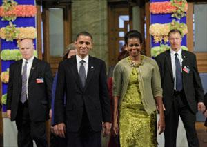 Nobel Peace Prize laureate President Obama enters the Nobel Peace Prize ceremony with first lady Michelle Obama at City Hall in Oslo. (John McConnico/AP)
