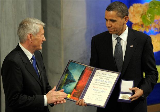 President Obama is applauded by Nobel Committee Chairman Thorbjorn Jagland after receiving the Nobel Peace Prize in Oslo. (Susan Walsh/AP)