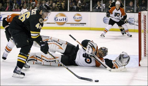 Philadelphia Flyers goalie Brian Boucher stretches to make a save on a shot by Boston Bruins center David Krejci during the second period of their game on Monday. (AP)
