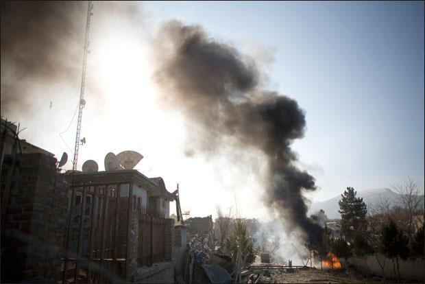 A car bomb burns near a building in Kabul, Afghanistan. (AP)