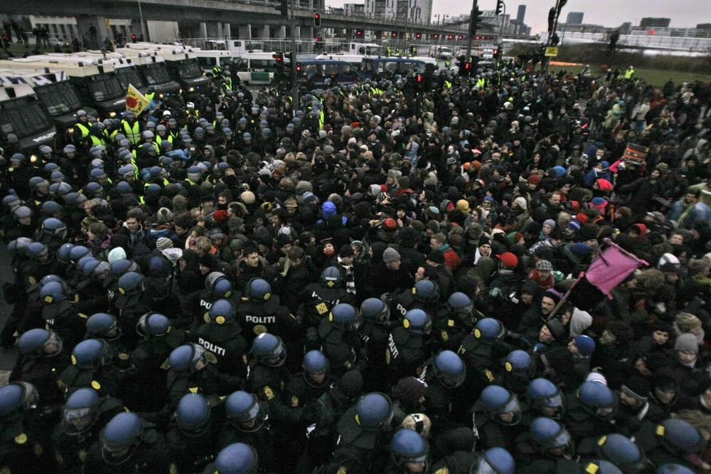 Danish riot police push back protestors Wednesday during a demonstration outside the Bella Center. (AP)