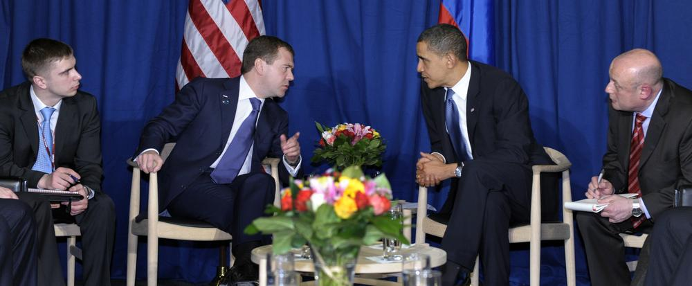 With translators on either side, President Barack Obama and Russian President Dmitry Medvedev talk during a meeting at the United Nations Climate Change Conference at the Bella Center in Copenhagen, Denmark, Friday, Dec. 18, 2009. (AP)