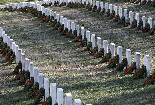 Wreaths are placed at graves as part of Wreaths Across America at Arlington National Cemetery in Arlington, Va. on Dec. 12. More than 16,000 wreaths were placed at graves throughout the cemetery. (AP)