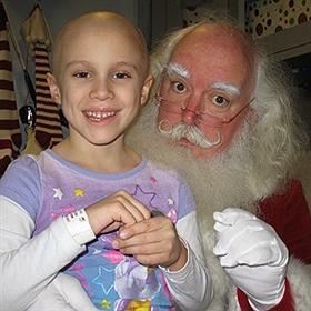 Santa Claus, a.k.a Jonathan Meath with Hannah Lowe. (Monica Brady-Myerov)