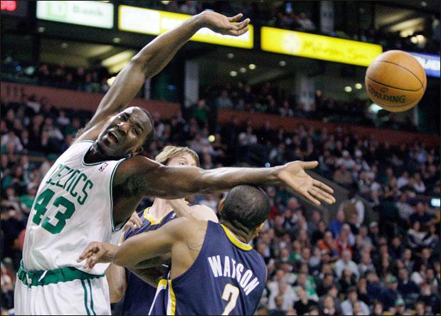 Boston Celtics center Kendrick Perkins can't reach an offensive rebound against Indiana Pacers forward Troy Murphy, center, and guard Earl Watson on Tuesday. (AP)