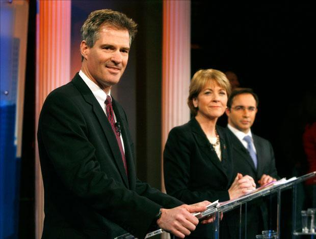 Republican Scott Brown, Democrat Martha Coakley and Libertarian Joseph Kennedy make last minute preparations before a debate at the WBZ-TV studios on Tuesday. (Steven Senne/AP)