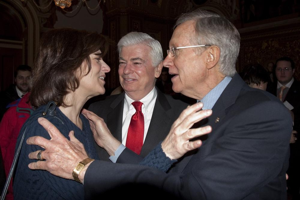 Victoria Kennedy, widow of Sen. Ted Kennedy hugs Senator Majority Leader Harry Reid of Nev. on Capitol Hill in Washington, Thursday, Dec. 24,2009, as Sen. Banking Committee Chairman Sen. Christopher Dodd, D-Conn, looks on at center, after the Senate passed the health care reform bill. (AP)