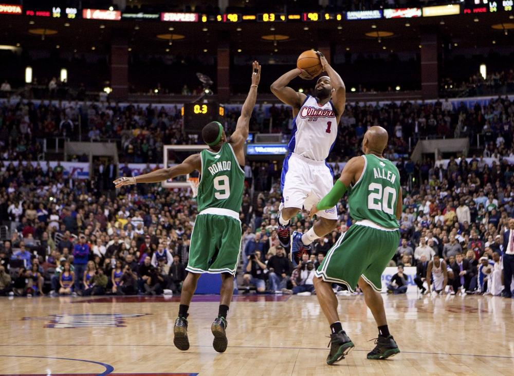 Los Angeles Clippers' Baron Davis hits the game-winning shot while being guarded by Boston Celtics' Rajon Rondo and Ray Allen to defeat the Celtics 92-90 on Sunday, Dec. 27 in Los Angeles. (AP)