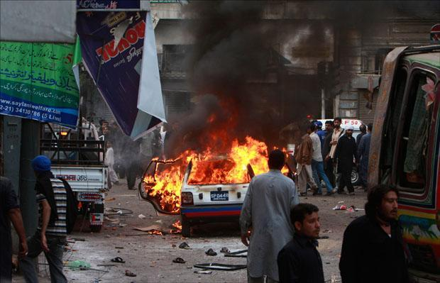 A vehicle is on fire after a bomb blast struck a Shiite Muslim procession in Karachi, Pakistan. (Shakil Adil/AP)