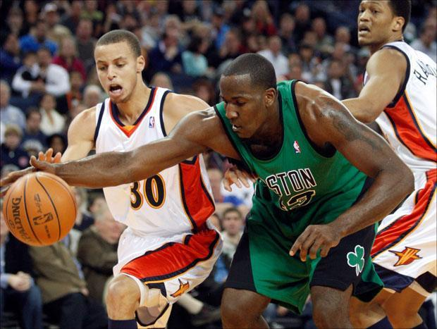 Boston Celtics' Kendrick Perkins tries to keep the ball from Golden State Warriors' Stephen Curry on Monday. (AP)