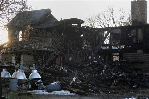 The remains of a house fire on 17 Fair St. as seen on Sunday. (Jessica Hill/AP)