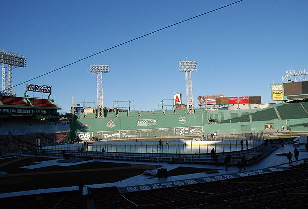 Under the looming Green Monster, the newly-constructed ice rink at Fenway Park awaits the NHL's 2010 Winter Classic.  (Sarah Bush/WBUR)