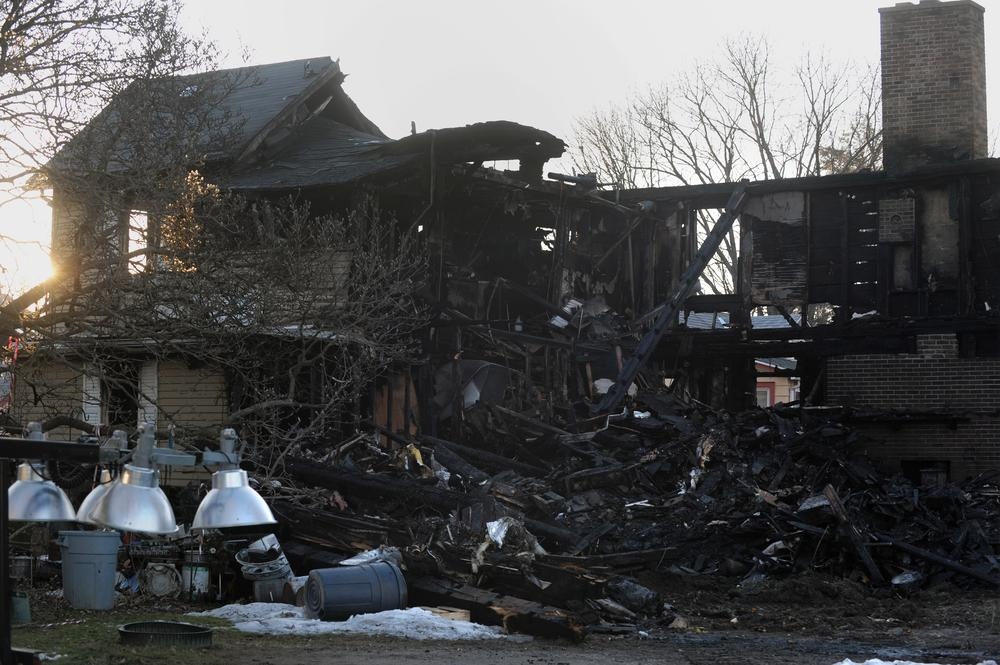 The remains of a house fire on 17 Fair St. is seen Sunday, Dec. 27, 2009, in Northampton, Mass. A father and son died in the house fire early Sunday morning as firefighters struggled to put out more than a half dozen blazes, authorities said.  (AP)