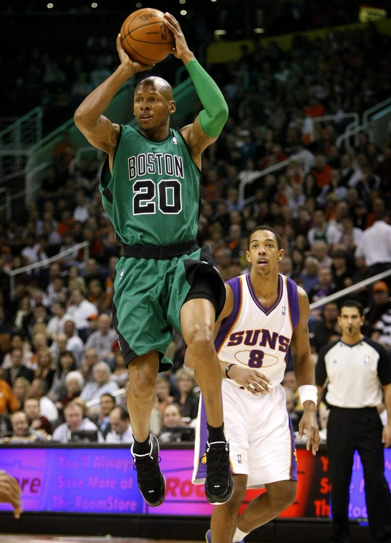 Boston Celtics' Ray Allen (20) looks to pass as Phoenix Suns' Channing Frye (8) looks on during the first half of an NBA basketball game Wednesday, Dec. 30, 2009, in Phoenix. (AP Photo/Matt York)