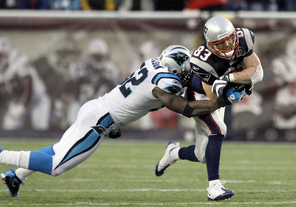 Patriots wide receiver Wes Welker is tackled by Panthers linebacker Jon Beason. (AP)