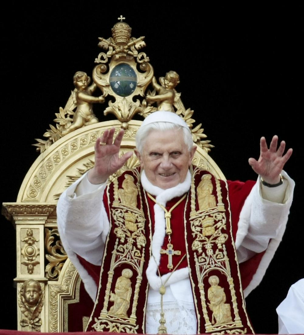 "Pope Benedict XVI waves to faithful during the ""Urbi et Orbi"" (to the City and to the World) message in St. Peter's square at the Vatican, Friday, Dec. 25, 2009. (AP)"