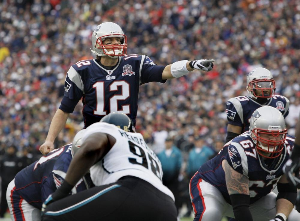 New England Patriots quarterback Tom Brady directs his team against the Jacksonville Jaguars during an NFL football game in Foxborough, Mass. on Dec. 27.  The Patriots won to clinch the AFC East Division. (AP)