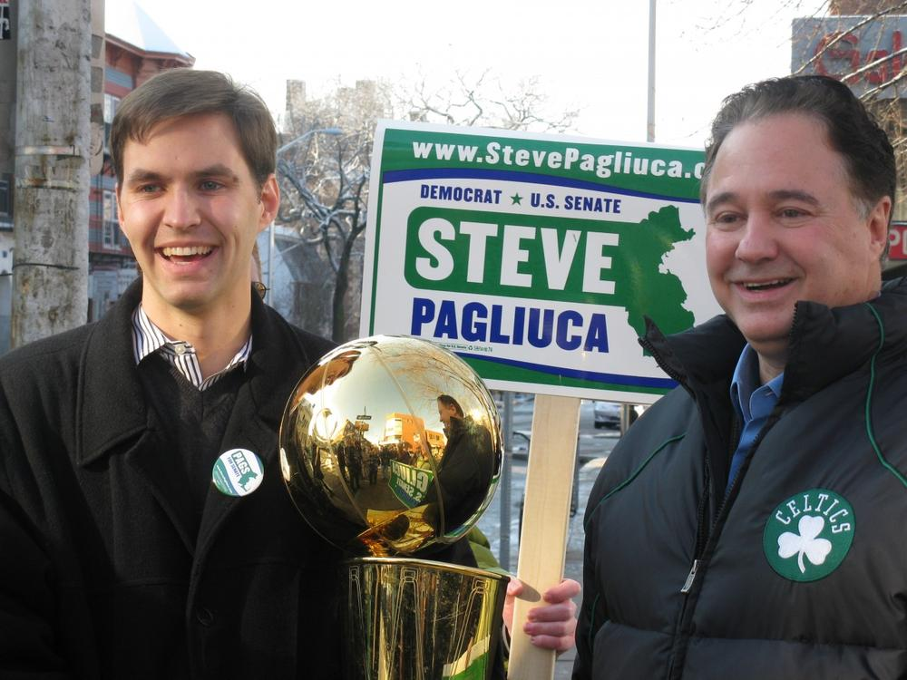 Stephen Pagliuca with his son, holding the Celtics championship trophy, in Harvard Square on Sunday. (Fred Thys/WBUR)