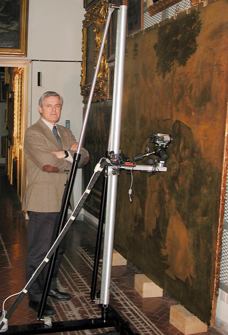 """Maurizio Seracini poses in Florence, Italy next to equipment used for investigations that the art conservationist believes may reveal Leonardo da Vinci's unfinished """"Battle of Anghiari"""" mural. (AP)"""