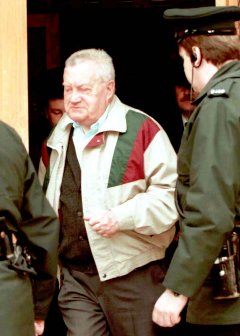 The late priest Brendan Smyth was accused of molesting children in Ireland, Britain, North Dakota and Rhode Island. In this undated file photo, Smyth leaves a courthouse in northern Ireland. (AP)