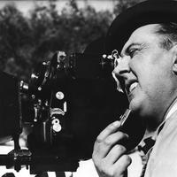 """French movie producer, Jacques Tati shoots a scene,  jumping in the role as camera man on the set producing his latest and third film """"Mon Uncle"""" (My Uncle) in France, April 1958. (AP Photo)"""