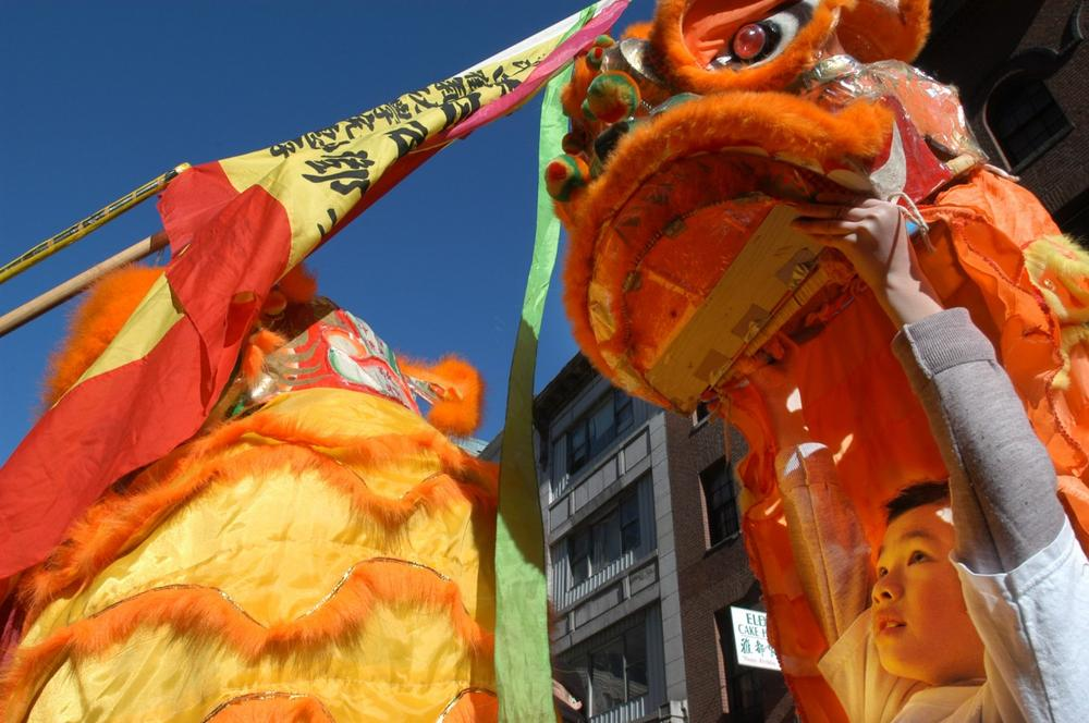 Win King Hu, 8, of Boston, performs a lion dance during a Lunar New Year celebration in Boston's Chinatown in 2004. (AP)