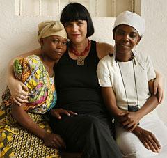 In this photo released by V-Day, Eve Ensler is joined by two women outside Panzi Hospital in Bukavu, eastern Congo. The hospital sees about 3,500 women a year suffering fistula and other severe genital injuries, victims of what a U.N. expert called the worst violence against women in the world. (AP)