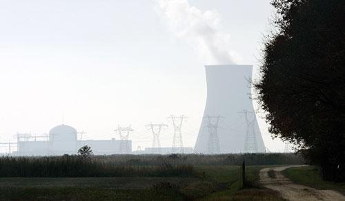 A large cooling tower and other buildings at the Salem nuclear power plant, known as Artificial Island, near a farm in Lower Alloways Creek Township, New Jersey, in 2007. (AP)